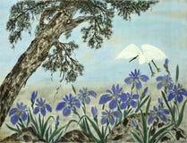 Tree, flowers  and crane Stock Photo
