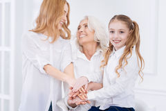 Tree generations of the family talking at home Royalty Free Stock Photography