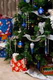 Tree and Gifts. A Christmas tree and various wrapped gifts royalty free stock image