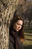 Tree girl 3. Girl posing behind a tree Stock Image