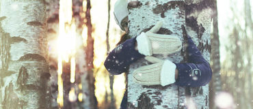 Tree girl hiding hands Royalty Free Stock Images