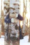 Tree girl hiding hands Stock Photo