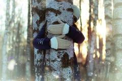 Tree girl hiding hands Stock Photos