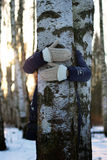 Tree girl hiding hands Stock Images
