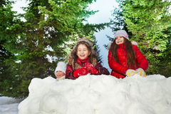 Tree girls playing snowballs at sunny winter day Stock Photography