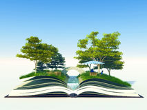 Tree growing from a book Stock Image