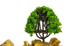 Tree growing on pile of gold nuggets, growth business finance investment concept. Idea stock image