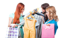Tree happy women shopping in clothes store Stock Photos