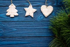 Tree, heart and star toys to decorate christmas tree for new year celebration with fur tree branches on blue wooden Stock Image