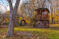 Tree house in autumn garden Royalty Free Stock Photo