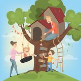 Tree house for children. Parents build and play Royalty Free Stock Images