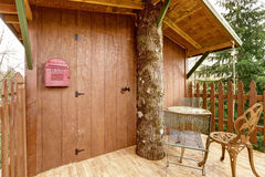 Tree house deck with entrance door Royalty Free Stock Photo