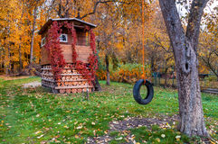 Tree house in garden, autumn Stock Images