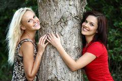 Tree Hugging Pretty Girls Royalty Free Stock Photo