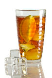 Tree ice cubes and cold tea in glass Royalty Free Stock Photo
