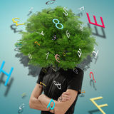 The tree of ideas. Portrait of man with tree on head royalty free stock images