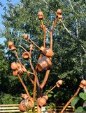 Tree of jugs in Bucharest, Romania. Jugs on an ornamental tree to lure and trap insects from surrounding fruit trees royalty free stock photography