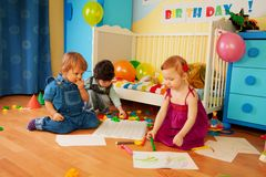 Tree kids drawing together Stock Photos
