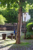 Tree lamp and old water pump in Cochem Germany. Old waterpump tree and trough in courtyard Stock Photo
