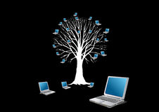 Tree with laptops Stock Photo