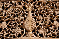 Tree of life, tangled branches and leaves carved on an old wall. Of the estate in Rajasthan, Indial stock photo