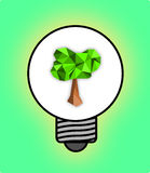 Tree light bulb  On a green background. Royalty Free Stock Image