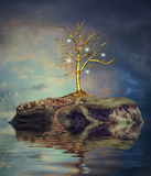 Tree with light bulbs on an island on the small lake Royalty Free Stock Photography