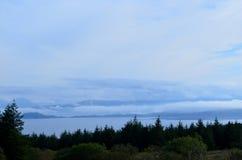 Tree Line at Bearreraig Bay. Blue skies and silhouetted tree line at Bearreraig Bay Stock Photos