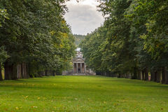 Tree Lined Avenue and Chapel. An avenue of trees leading to an 18th century chapel at Gibside estate, England Stock Photography