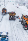 Tree Lined-up Snowplows Clearing the Highway Royalty Free Stock Images