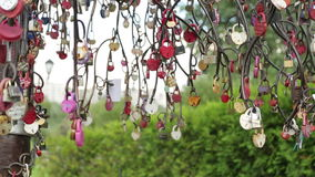 Tree with locks. Wedding traditions. Metal tree with multi-colored ribbons and locks. Old wedding tradition. Rusty metal product in the form of a tree stock video