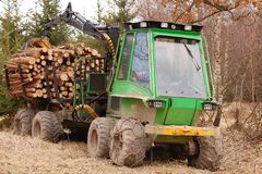 Tree log hydraulic manipulator - tractor Stock Photos