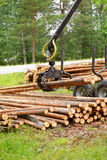 Tree log hydraulic manipulator - tractor Stock Photography