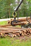 Tree log hydraulic manipulator - tractor Stock Photography