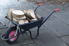 Tree Logs in Wheel Barrow royalty free stock images