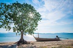 Tree with long tail boat on the beach at Naka Noi Island Phuket, Royalty Free Stock Photography
