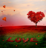 Tree of love in autumn. Red heart shaped tree at sunset.Autumn s. Eason concept.Beautiful landscape with red tree and falling leaves.Love bacground Royalty Free Stock Photography