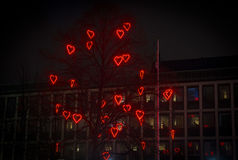 Tree of love. Tree decorated with red neon hearts for Saint Valentine`s day in Stockholm Suburbs Royalty Free Stock Images