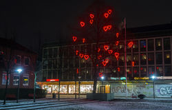 Tree of love, Stockholm 19 February 2016. Tree decorated with red neon hearts for Saint Valentine`s day in Stockholm suburbs Stock Photos