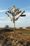 Tree made of multicolored plastic bottles. Recycling and waste reduction concept Stock Image