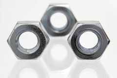 Tree metal nuts, closeup Stock Images