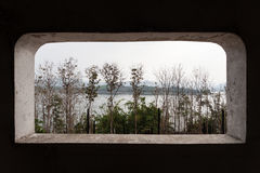Tree and mountain views from the window. Of pagoda at Kanchana Buri, Thailand Royalty Free Stock Photo