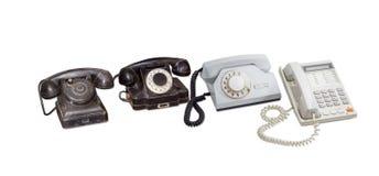 Tree old telephone sets and modern landline telephone Royalty Free Stock Image