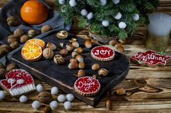 Tree, Orange, orange slices and biscuits snowflakes lie on the wood table stock images