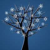 Tree over blue snow crystals Royalty Free Stock Image