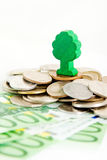 Tree over a pile of money Stock Image