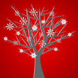 Tree over red with snow crysta Royalty Free Stock Images