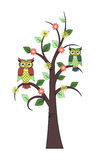 Tree with owls and flowers Stock Photo