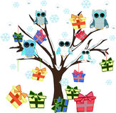 Tree with owls and gift boxes at winter Royalty Free Stock Image
