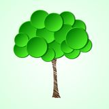 Tree with a paper crown and a painted stem. Royalty Free Stock Photography